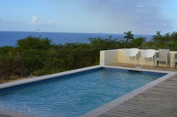 Prachtig huis te huur op blue bay resort curacao met for Villa met zwembad te huur