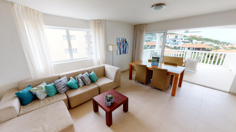 RE/MAX real estate, Curacao, Blue Bay, Triple Tree 31 - furnished corner condo on 4th floor with ocean views