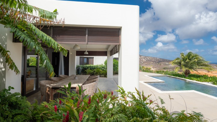 Modern villa with pool and seaview on resort with beach and golf
