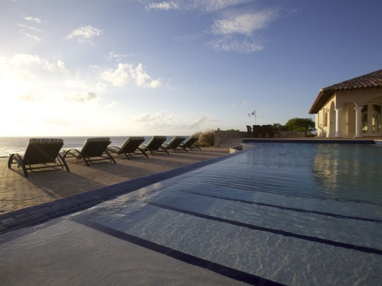 Stunning oceanfront setting for this 4-bedroom villa - Amazing price!