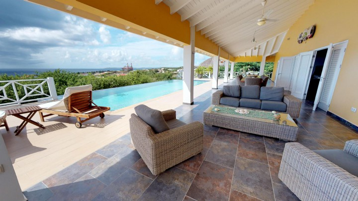 Oceanfront villa for sale on golf course with pool and ocean view