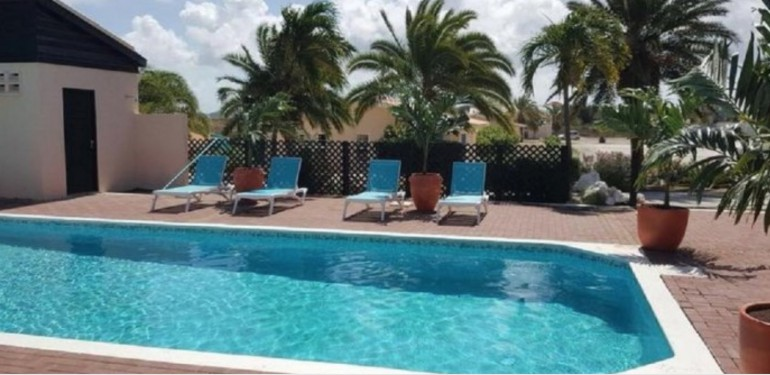 Best priced plots on Curacao in gated community with pool.