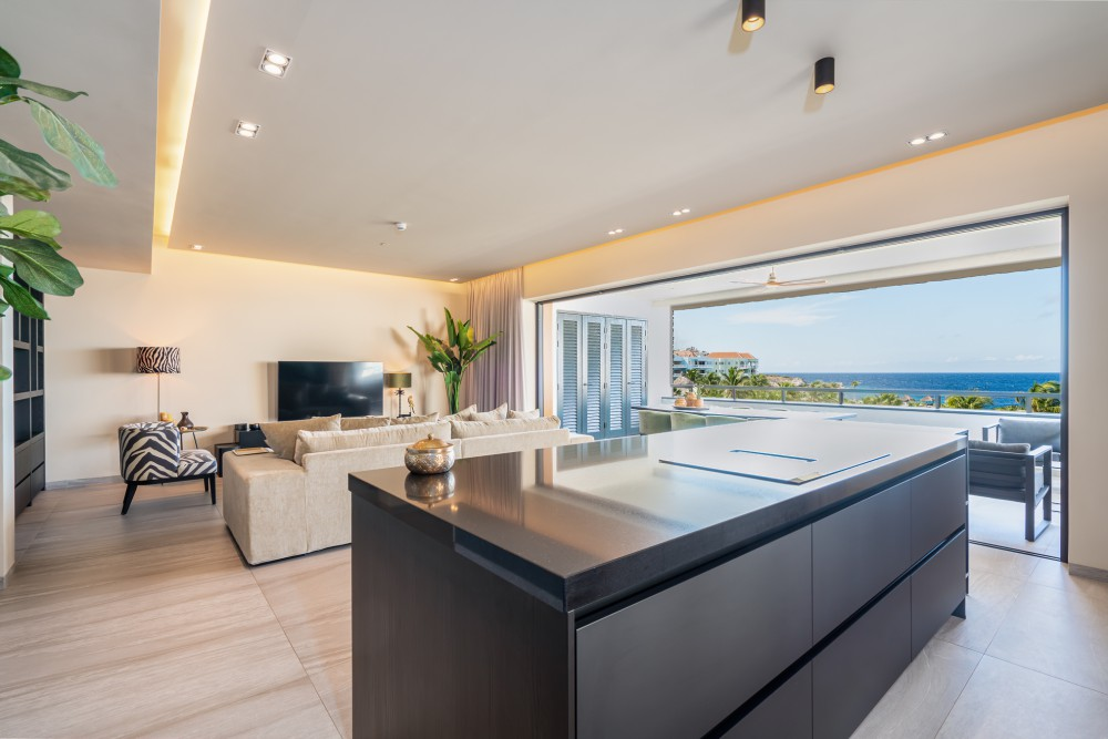 RE/MAX real estate, Curacao, Blue Bay, New corner apartment with sea view and pool on beach Blue Bay Resort